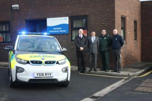 (From R-L) Stuart Rankine, Vehicle and Equipment Manager for NWAS; Neil Maher, Assistant Director Service Delivery Support for NWAS; Gary Eaton, Operations Manager for NWAS; and Nick Withington, Regional Operations Manager for BMW Group, test out the new electrically powered rapid response vehicle at Rochdale ambulance station.